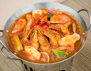 54dd5c10761358d52c096cff_Fiery-Assam-Prawns-in-Claypot.jpg