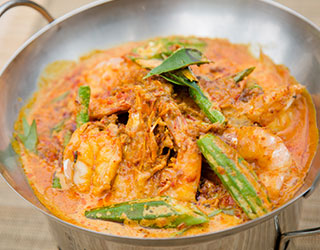 54dd5bf5761358d52c096cfd_Nyonya-Curry-Prawns-in-Hot-Wok.jpg
